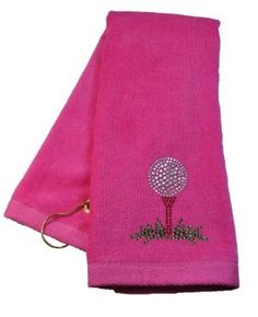 Navika Pink Golf Tee Towel Accented with Crystals by NAVIKA USA Inc.. $27.95. Navika Designs. Makes a Great Gift & Tee Prize. Add some BLING to your game!. Crystal Embellished 100% Terry Cloth Golf Towel. Clip to Latch onto Golf Bag. Pink Golf Tee crystal embellished towel by Navika Designs. 100% terrycloth ladies golf towel with a clip to latch onto golf bag. Bring some BLING and style onto the golf course!