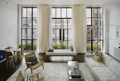 These rooms seem to have a common feature: oversized, steel-framed factory windows. This architectural feature seems to be incredibly defining and unique, yet modest at the same time.