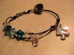 Linked ~ Crystal, Light Blue and Blue Zircon Swarovski w/ Swarovski chandelier pendant & puzzle charm