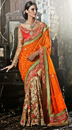 Fashionable beige and orange faux georgette and net half and half saree which is adorned with floral patch and resham embroidery work on the first half, lace work in the horizontal panel, cut work on the lower part and zari embroidery work on the border. This outfit comes with a matching blouse piece. The blouse of this saree can be stitched in the maximum bust size of 42 inches. Product Code 3FD4544475