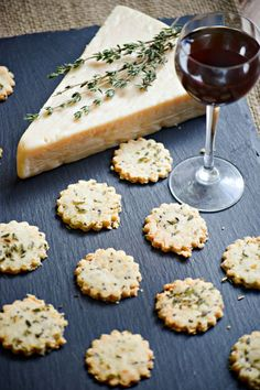 Gluten Free Asiago Almond Crackers are perfectly paired with a glass of wine -- great for entertaining, parties or everyday snacking celebrations!