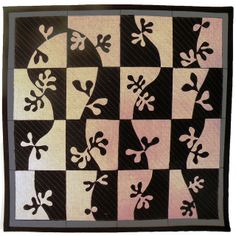 Black and white quilt in solids. This quilt looks like a Matisse design