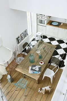 Kitchen with black and white tiling-- contrasting with wood