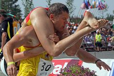 Strange is not a word : the most bizarre festivals around the global village WIFE CARRYING , SONKAJARVI , FINLAND