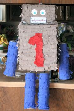 DIY Robot pinata made from cereal boxes, pringle canisters and a kleenex box for a head.