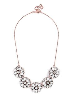 Five crystal rosettes accent this delicate necklace for a stellar yet understated crystal embellishment.