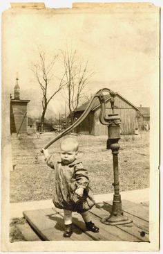 Farm Baby Toddler Standing Holding Water Well Pump Handle Vtg 1910s