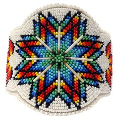 Created by American Indian artist Leonard Good Bear, a member of the Cheyenne River Sioux tribe of South Dakota. Indian Beadwork, Native Beadwork, Native American Beadwork, Seed Bead Patterns, Beading Patterns, Native American Patterns, Beadwork Designs, Nativity Crafts, Beading Projects