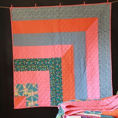 Handmade in Australia - One of a kind Quilt. Great as a throw quilt on the end of a bed. Fantastic for the lounge, out in the garden for a picnic and it can be hung on the wall as a work of art. All quilts are made with specially collected fabrics and designed and pieced by Siobhan Rogers. The Quilts are machine washable and made from 100% natural fibres.
