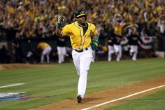 """It's the ninth inning, with the score still tied at 0-0 in the A's second playoff game of 2013. But in front of a home crowd of 48,000, with the bases loaded, Stephen Vogt drove a single into left field, and everyone at O.co Coliseum knew what it meant.  Yoenis Cespedes pumped his fist while trotting in to home to score the game-winning run. (From """"ALDS Game 2: Starters Dominate, Vogt Walks Off"""" at the Athletics Nation web site)"""