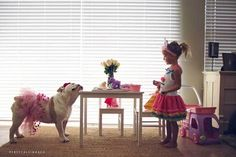 Photographer captures the playful friendship between her daughter and Bulldog (PHOTOS)