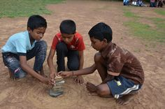 Learn to play Seven Stones, a Traditional Game in #India #game #children