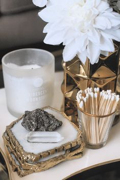 Easy Ways to Decorate with Crystals - Sarah Grace at Home - Lara's Wonderland - Easy Ways to Decorate with Crystals - Sarah Grace at Home quartz coasters, flowers, candle, matches, coffee table - Coffee Table Styling, Diy Coffee Table, Decorating Coffee Tables, Coffee Table Candle Decor, Coffee Table Decorations, Coffee Table Flowers, Coffee Table Coasters, Candle Decorations, Bar Cart Styling