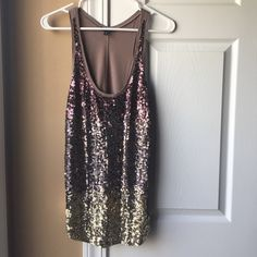 Express sequin ombré tank Gorgeous all sequin ombré tank top! Like new condition, super pretty on! Worn for New Years (last pic, in middle) Colors- brown and tan sequins Express Tops Tank Tops
