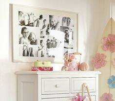 photos above dresser in large collage frame + black & white ,