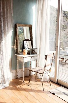 Bright morning light, pale blue walls, old furniture, wood floors, boho, antique