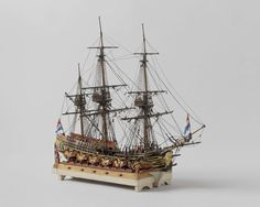 Model of the 24-gun frigate Schout bij nacht May in ship's camels, Anonymous, , c. 1810 - c. 1820
