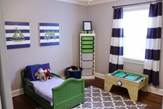 navy blue & green toddler boy bedroom; transportation theme room