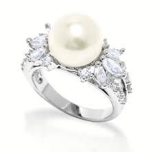 There are a few reasons as to why I would choose a pearl over a diamond on my engagement ring:  1) It's far less expensive.  We could use that money in a far more effective way.  2) Diamonds are some of the hardest rocks.  Hardly anything can scratch them up, making them capable of being extremely useful tools.  Why waste a diamond on a ring?  3) Pearls are extremely beautiful.  They have a unique origin in coming from the sea, and they remind me of the glowing moon in the sky.  So…
