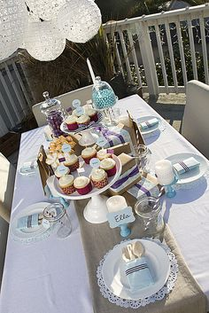 Lovely colors for a boy baby shower! I like the different heights on the centerpieces