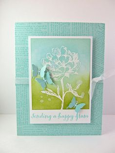Love the image embossed in white and sponged with distress inks for the background!