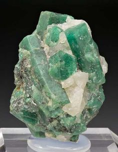 Beryl  Emerald Size: Small Miniature 3.8x2.7x1.7 cm Location:Colombia Description:Green prismatic semi-lustrous crystals of emerald up to 2.0 cm in length frozen within a 3.8 x 2.7 x 1.7 cm matrix. Nice specimen. Ex Sal Avella collection.