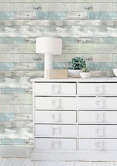 "Create your own rustic haven with this chic peel and stick wallpaper! Giving walls the look of weathered wood with hints of soft pale color, this authentic looking design is not only beautiful but so easy to install. Printed on a premium peel and stick material that is totally removable and will not damage walls, this perfect solution for refreshing your home saves you both the time and hassle of ordinary wallpaper. Comes on a 20.5"" x 18' roll."