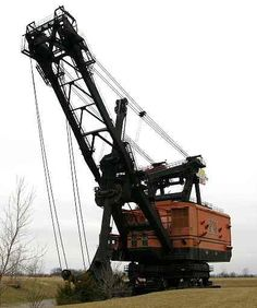 Big Brutus ~ Cherokee County, Kansas  -largest electric shovel in the world  16 stories tall (160 feet)  weight 11 million pounds  boom 150 feet long  dipper capacity 90 cu. yds (by heaping, 150 tons   — enough to fill three railroad cars.)  maximum speed .22 MPH  cost $6.5 million (in 1962)