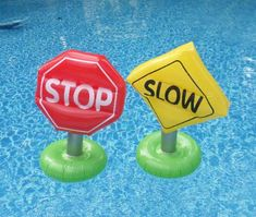 "Weighted inflatable traffic signs are able to float, but they can't always get ""pool traffic"" to slow down or stop :).  Get more Cars party ideas ..."