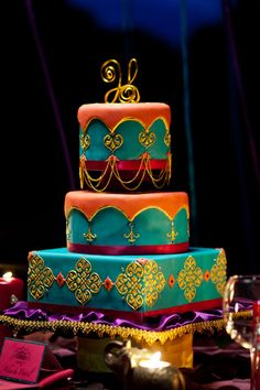 Blue and orange and yellow really make a stunning cake! #indian #weddingcake
