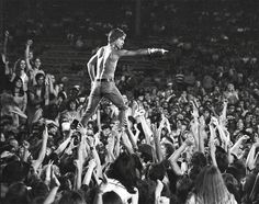 Iggy Pop of the Stooges rides the crowd during a concert at Crosley Field on June 1970 in Cincinnati, Ohio. Get premium, high resolution news photos at Getty Images Concert Rock, Concert Festival, Le Concert, Iggy Pop, Punk Rock, Rock N, Rock And Roll, Louis Armstrong, Mick Jagger