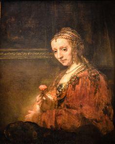 Rembrandt van Rijn - Woman with a Pink, 1660's at Metropolitan Museum of Art New York City NY