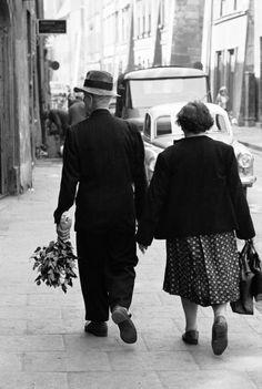 Elderly Polish couple walking hand in hand, Poznan, 1963 (Paul Schutzer)