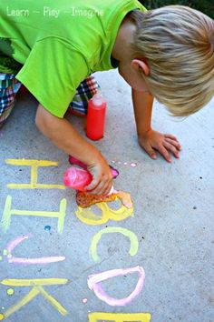 ABC Eruptions - a fun prewriting exercise with erupting sidewalk chalk paint using Kool aid instead of vinegar!  Build fine motor skills and learn letters while creating cool eruptions. Could also be done inside in a sensory tub :)