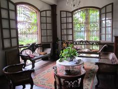 love the windows minus the bars Philippine Architecture, Filipino Architecture, Architecture Design, Modern Tropical House, Tropical Interior, Asian Inspired Decor, Asian Decor, Modern Filipino Interior, Lanai Design