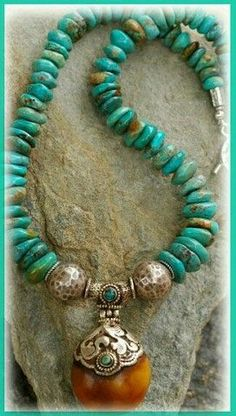 IN THE MIX A stunning Nepalese handcrafted pendant of sterling silver & amber with two turquoise cabochons. This turquoise is from Kingman, Arizona. It has a beautiful golden brown matr African Jewelry, Tribal Jewelry, Turquoise Jewelry, Boho Jewelry, Jewelry Crafts, Beaded Jewelry, Jewelery, Silver Jewelry, Handmade Jewelry