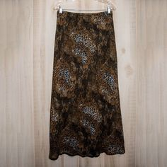 Lacy Floral Printed Maxi Skirt This skirt is in Like New condition!   Features:  * Maxi  * Brown * Lace and floral pattern * Elastic waist  Materials: * 100% Polyester   Measurements:  * Size medium * Waist is 30in.   * Length is 38in.    No trades. Ask any questions! Vintage Skirts Maxi