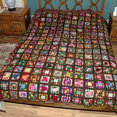 Rare brown background granny square.  Rainbow wool 70s afghan... So perfect for Fall!