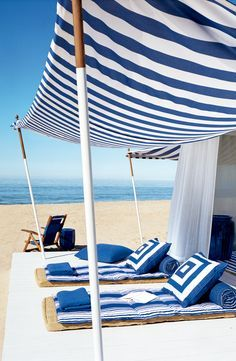 A canopy of striped blue and white fabric makes the perfect, lounge-worthy beach cabana. From Ralph Lauren Home.