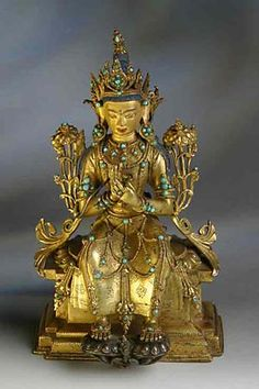 Maitreya, the Buddha of the Future, seated upon his throne in the heavens, awaiting his call to minister on earth.  Central Tibet.  15th c.  gilded bronze