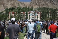 Khorug residents at a central square on August 22 protest reports of the Tajik authorities' killing of former rebel field commander Imomnazar Imomnazarov.