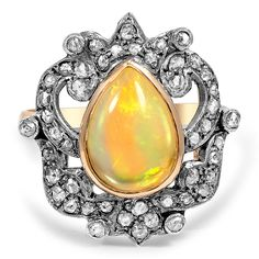 Brilliant Earth - The Aurea Ring $3,490 Only One available!  This one-of-a-kind 18K yellow gold piece showcases a bezel set pear-shaped opal in a 14K white gold top. Rose cut diamonds glitter from the ornate top for a uniquely bold Victorian-inspired look (approx. 0.48 total carat weight).