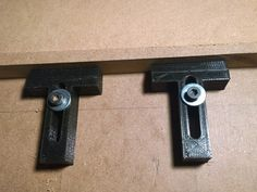 """This is a parametric 'T' clamp hold down for use securing work on a CNC mill table or similar. My assumption is that you will use M5 screws to hold down the clamps. If you want a different size screw, it should be easy to change the slot width. It has a nose cutout so that it can be used to secure thin sheet work. If you want to remove the cutout, you can modify the openscad script and change the """"nose"""" variable to false."""