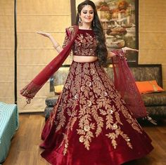 Buy maroon velvet with precipitant lace work & embroidery work designer lehenga choli online.This set is features a maroon blouse in velvet fully embellished with resahm, embroidery.It has matching maroon lehenga in velvet with beautiful embroidery al Wedding Lehnga, Pakistani Wedding Outfits, Indian Bridal Outfits, Pakistani Wedding Dresses, Pakistani Dress Design, Wedding Bride, Designer Bridal Lehenga, Bridal Lehenga Choli, Red Lehenga