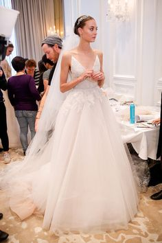 Backstage at Monique Lhuillier Bridal Spring/Summer 2016.