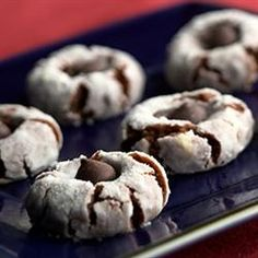 Fudgy Peanut Butter Buttons. Ingredients: hot cocoa mix, peanut butter, light corn syrup, confecctioners' sugar, vanilla wafers, chocolate morsels