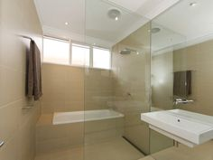 """Another bathroom with the bath behind the shower, turning half of the room into a sort of """"wet room"""". A whiter, less hotel-y version of this is the kind of look we're after"""