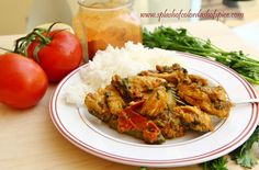 Karahi Chicken - a spicy tomato based curry with garlic, ginger, cilantro, coriander and fenugreek leaves