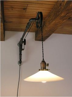Incredible industrial wall sconce by Susanne in Germany made from iron piping, pulleys, and socket/shade fitter and black cloth covered twisted wire from Snake Head Vintage lighting supply company