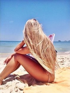 Long blonde hair where it belongs, the beach!